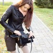 Woman searching in her handbag — Stock Photo