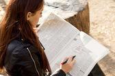 Jobseeker reading the classified adverts — Stock Photo