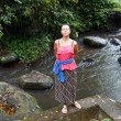 Attractive woman standing above a river — Stock Photo #15783275