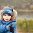 Постер, плакат: Cute cold little boy hugging himself