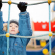 Child playing in a kids playground — Stock Photo