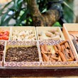 Stock Photo: Trays of dried spaces and herbs for sale