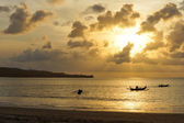 Three outrigger canoes at sunset — Stock Photo