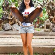 Woman holding a flying fox — Stock Photo