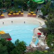 Swimming pool with water feature at a resort - Photo
