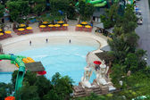 Swimming pool with water feature at a resort — Stok fotoğraf