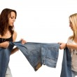 Постер, плакат: Two teenagers fighting over jeans