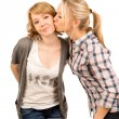 Affectionate teenager giving her friend a kiss — Stock Photo