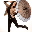Carefree playful girl with an umbrella — Stock Photo