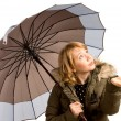 Stock Photo: Womin winter jacket and umbrella
