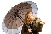 Woman in a winter jacket and umbrella — Stock Photo