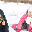 Two young children playing in snow - Stok fotoraf