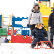 Happy family in a kids winter playground — Stock Photo