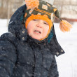Cute little boy in a flurry of snow — Stock Photo #18038217