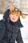 Cute little boy in a flurry of snow — Stock Photo