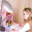 Cute little girl at her desk — Stock Photo