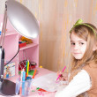 Cute little girl at her desk — Stock Photo #20009561