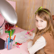 Small girl drawing at her desk — Stock Photo