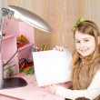 Stock Photo: Cute little girl showing blank paper