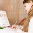Little girl doing her homework — Stock Photo #20009599