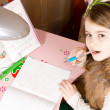 Young girl doing school work — Stock fotografie