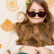 Young girl posing large sunglasses — Stock Photo