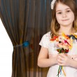 Little girl posing with flowers — Stock Photo