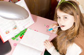 Young girl doing school work — Stock Photo
