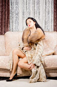 Glamorous woman in a fur coat — Stock Photo