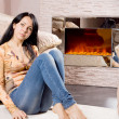 Serious attractive woman relaxing at home — Stock Photo