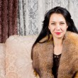 Happy woman in a luxurious fur coat — Stock Photo #22246025