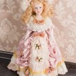 Antique doll in beautiful clothes — Stock Photo
