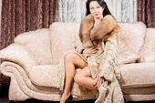 Glamorous woman in a fur coat — Stock Photo