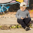Pensive little boy sitting thinking - Stock Photo