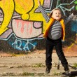 Stock Photo: Little boy jumping for joy