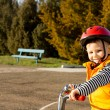 Happy small boy out riding his bicycle - Stock Photo