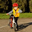 Little boy mounting his bicycle — Stock Photo