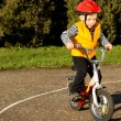 Cute young boy practising riding his bike — Stock Photo #24406113