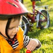 Little boy out cycling drinking bottled water — Stock Photo