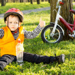 Small boy out riding giving a thumbs up — Stock Photo
