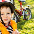 Mischievous little boy in a safety helmet — Stock Photo