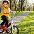 Adorable little boy riding his bike — Stock Photo