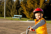 Happy small boy out riding his bicycle — Stock Photo