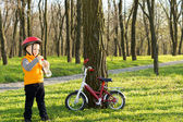 Little boy out riding stopping for a drink — Foto Stock