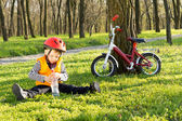 Cute young boy out riding on his bicycle — Stock Photo