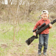 Stock Photo: Small boy carrying rifle
