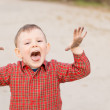Cute little boy trying to scare the viewer — Stock Photo #24592763