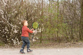 Little boy catching a frisbee — Stock Photo