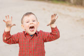 Cute little boy trying to scare the viewer — Stock Photo