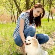 Smiling woman with her cute dog — Stock Photo